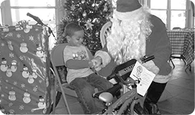 Little boy with Santa.